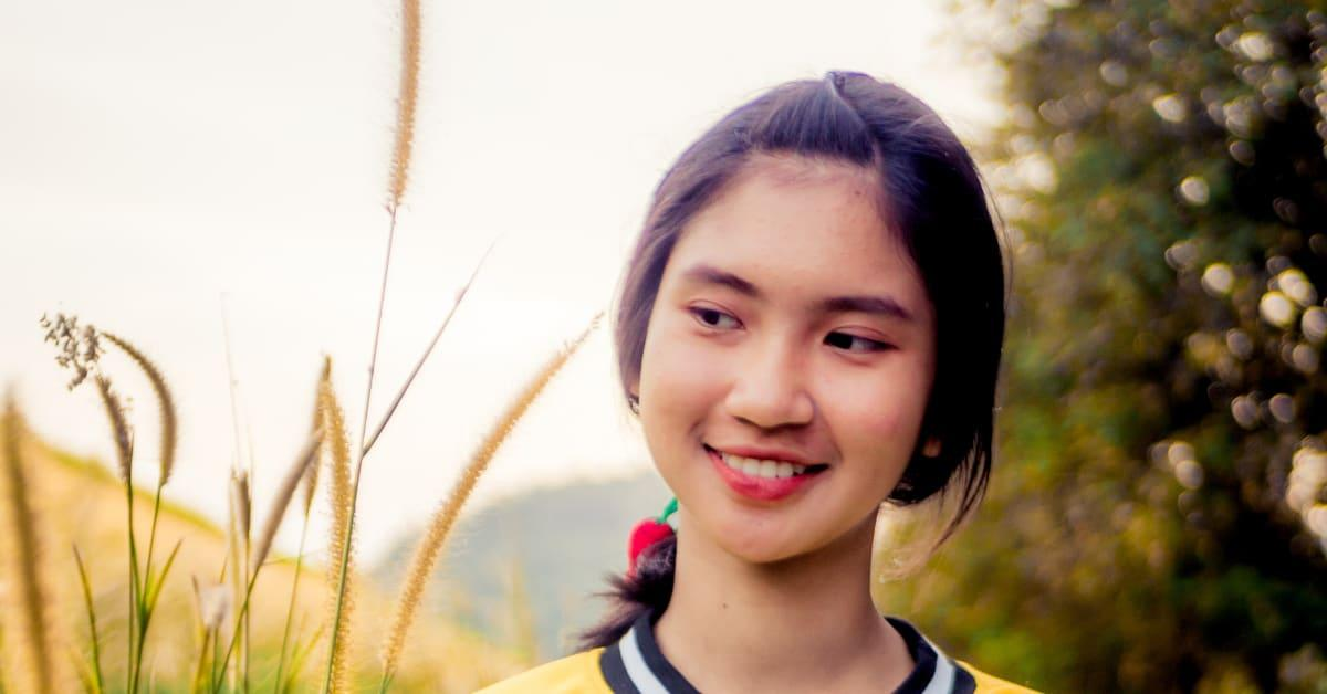 Young thai woman in field